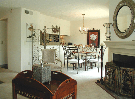 The B1 2 Bedroom Apartment at Breckinridge Court Apartments has two baths, a corner fireplace and kitchen with an open bar looking into the dining room.